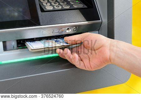 Caucasian Man Hand Taking Bulgarian Levs From Atm. Receive Money At A Cash Machine Outdoors. Atm Cas