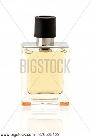 Perfume Or Scented Toilet Water In A Rectangular Transparent Glass Bottle With A Black Cap Isolated