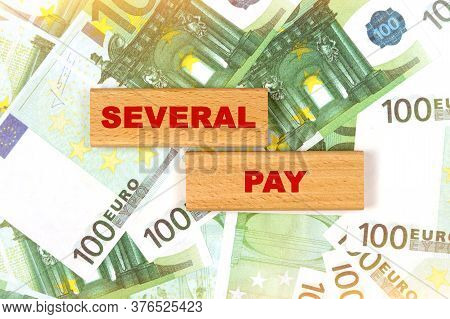 Business Concept. Against The Background Of Euro Bills, The Text Is Written On Wooden Blocks - Sever