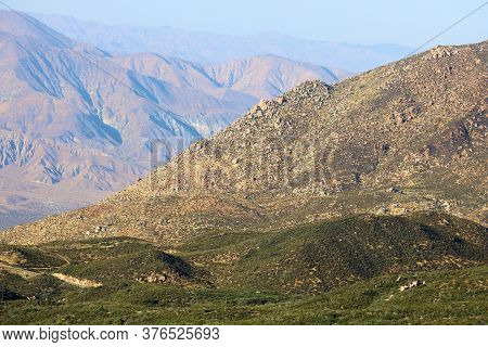 Lush High Desert Plateau With A Chaparral Woodland Overlooking Arid Mountains Taken In The San Jacin