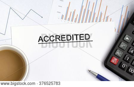 Accredited Document With Graphs, Diagrams And Calculator And A Cup Of Fragrant Coffee