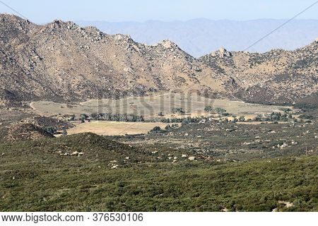 Rural Valley Besides Arid Mountains And Chaparral Woodlands Taken In The San Jacinto Mountains, Ca