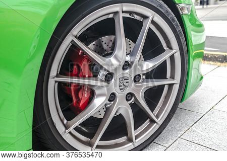 Wetzlar, Germany 2020_06_11: Beautiful Wheel Rim Of A Porsche Car. Porsche Ag Is A German Motor Vehi