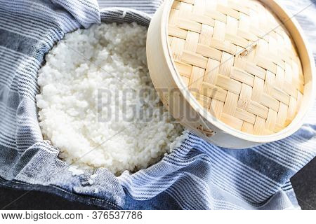 Simple Food Ingredients Concept, Sticky Sushi Rice In Traditional Asian Bamboo Steamer