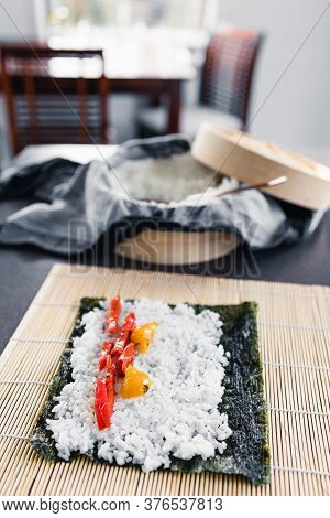 Plant-based Food, Vegan Sushi With Seaweed And Sticky Rice With Capsicum Getting Prepared