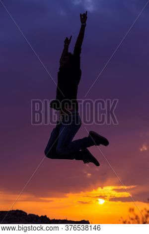 Young Silhouette Of A Man, Businessman Silhouette Jump Happy Sunset Sunrise Sky Background For Freed