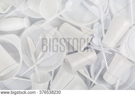 Food Plastic On Grey Background. Concept Of Recycling Plastic And Ecology. Plastic Waste. Flat Lay,