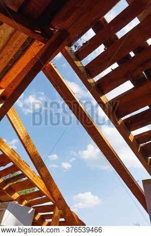 old roof renovation, frame of the roof against blue sky background