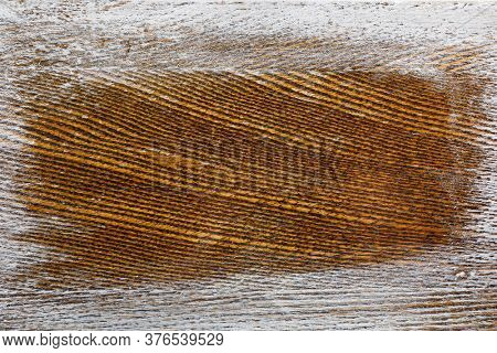 wooden brown background with white scratched frame