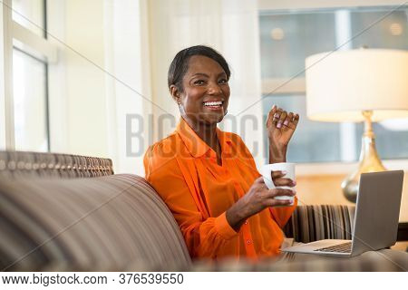 Mature Older Woman On Her Computer Working From Home.