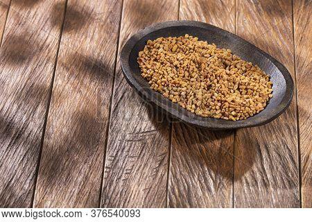 Organic Fenugreek Seeds In The Bowl. Trigonella Foenum-graecum