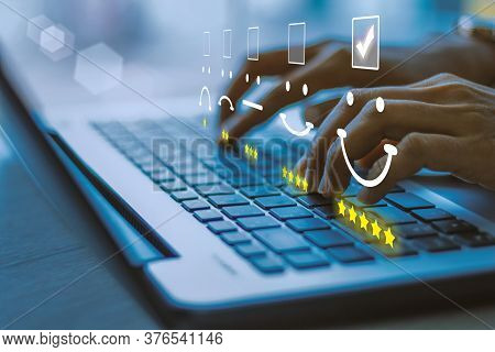 Businesswoman Pressing Face Emoticon On The Keyboard Laptop .customer Service Evaluation Concept.blu