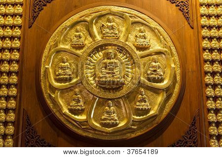 Golden Chinese Buddha On Wooden Wall