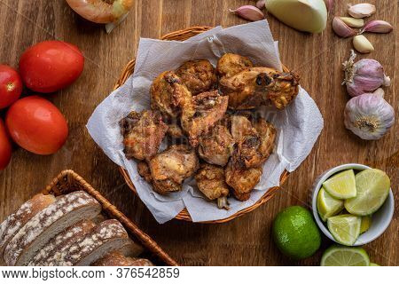 Brazilian Style Deep Fried Chicken And Sliced White Bread. Called Frango A Passarinho. Top View