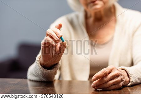 Partial View Of Senior Woman Holding Pill, Selective Focus