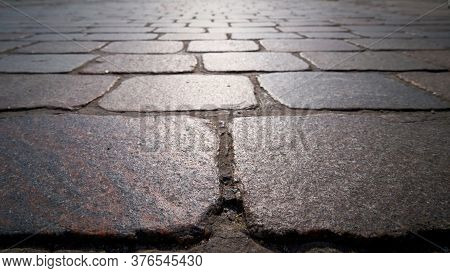 Cobblestone Pavement Of A Street In Magdeburg With Backlight