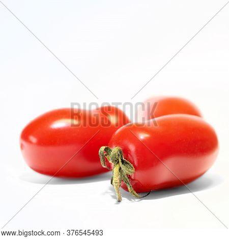 Ripe Roma Tomatoes (solanum Lycopersicum) With White Background