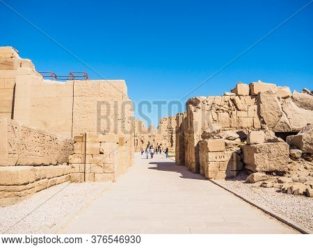 Luxor, Egypt - February 2020: Tourists Walking Amid Ruins In Karnak Temple And Seeing The Sights, Lo