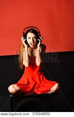 Girl With Loose Hair Wears Headphones. Singer With Surprised Face