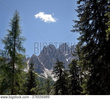 View Of The Mountain Range Of The Italian Dolomites, Trees, Blue Sky, Clouds