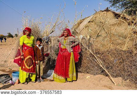 Jaisalmer, India - Dec 30, 2019: Beautiful Dressed Family Working On The Cotton Fields Of Jaisalmer,