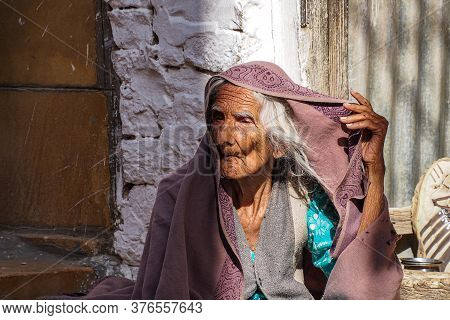 Jaisalmer, India - Dec 31, 2019: Indian Rajasthani Old Woman In National Clothes In The Streets Of J