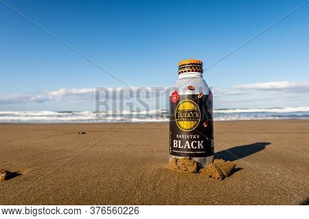 Chirihama Beach Driveway, Noto, Japan, 10/11/19. Bottle Of Hot Tully's Coffee Barista's Black  Burie