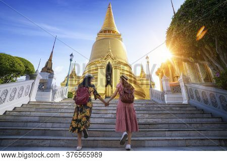Two Asian Girlfriends Traveling And Check Location By A Map In Grand Palace And Wat Phra Kaew Bangko
