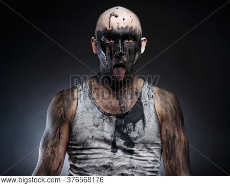 Photo Of Bald Mad Man With Dirty Make-up And Tongue