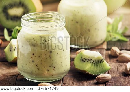 Green Smoothie With Banana, Kiwi Fruit And Pistachio, Old Wooden Background, Selective Focus