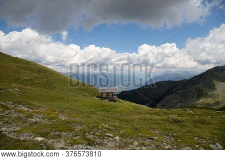 Scenery Of Italian Dolomite, Green Meadow With Flowers On The Background Of A Rock Massif With Blue