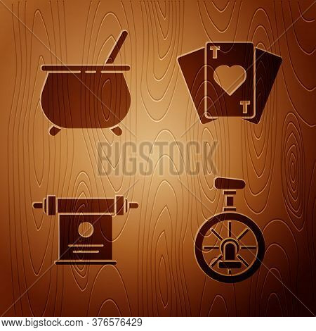 Set Unicycle Or One Wheel Bicycle, Witch Cauldron, Magic Scroll And Playing Cards On Wooden Backgrou