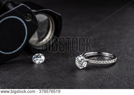 Engagement Diamond Ring And Diamond Gemstone With Jewelry Loup
