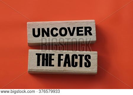Uncover The Facts Word Wood Blocks On Red. Fake Or Real News Concept