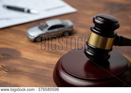 The Judge Hammer Is Next To The Car And Documents. Driver License Revocation Concept