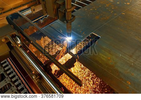 Cnc Cutting Machine Cuts A Sheet Of Metal. Plasma-air Cutting Of Metal. Many Sparks And Incandescent