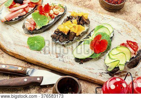 Set Of Bruschetta On Cutting Board