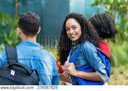 Young Adult Female Student With Retainer And Group Of Friends Outdoor In City In Summer