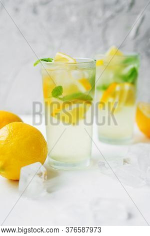Two Foggy Glasses With Homemade Lemonade On A Light Background. Cooling Drink In The Hot Summer. Lem