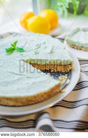 Mint Homemade Pie With Lemon Zest On A Striped Tablecloth. Summer Dessert On A White Table.
