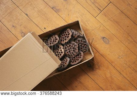 Dried Lotus Seed Pods In A Box On An Old Wooden Floor. Flower Delivery. Dried Flowers For Interior D