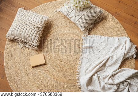 A Cozy Place To Read On The Floor. Jute Woven Round Carpet, Macramé Pillows, Plaid And Book.