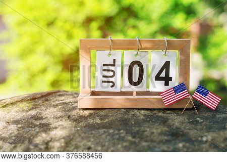 Folding Calendar With The Date Of July 4th On A Stone Parapet. Us Independence Day.