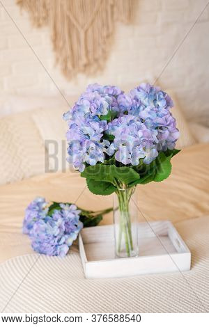 Bouquet Of Purple Hydrangeas On A Tray On The Bed In The Bedroom In The Style Of Boho. Morning Compl