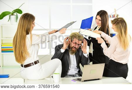 Welcome To Play. Business Colleagues In Modern Office. Stressed Boss Is Surrounded By Assistants. Wo