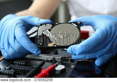 Close-up Of Middle-aged Man Repairing Detail Of Device. Technician Male Fixing Metal Computer Mainbo