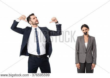 Arrogant Businessman Pointing With Thumbs At Himself Near Businesswoman With Scotch Tape On Mouth Is