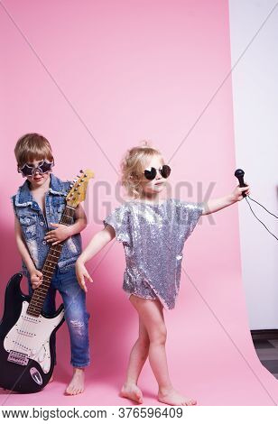 Pop Culture: Children A Boy With A Guitar And A Girl With A Microphone Pretend To Be Popular Musicia