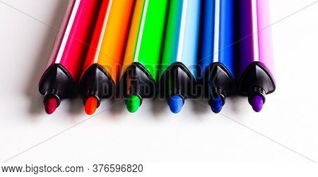On A Light Background Are Open Multi-colored Felt-tip Pens. Close-up