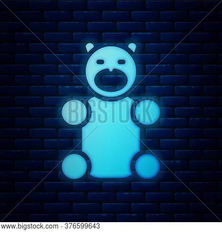 Glowing Neon Jelly Bear Candy Icon Isolated On Brick Wall Background. Vector
